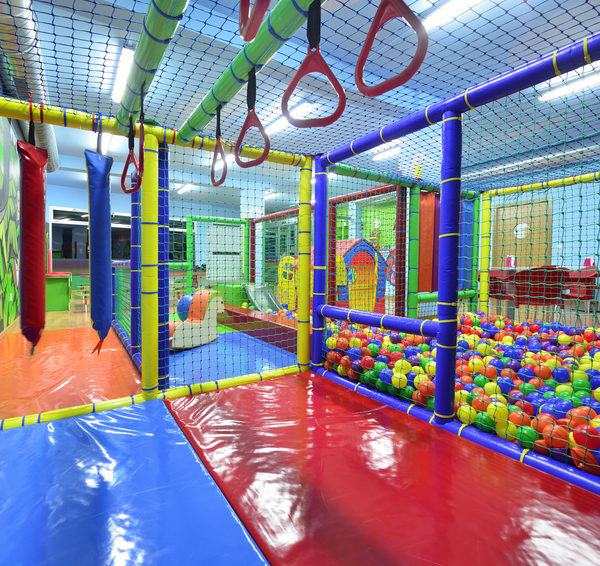 Go Play Systems Custom Design: ball room, monkey bars, padded floors, riding toys
