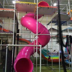 Pink tube corkscrew spiral slide attraction