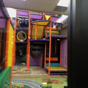 themed cityscape traffic carpet with high rise indoor playground