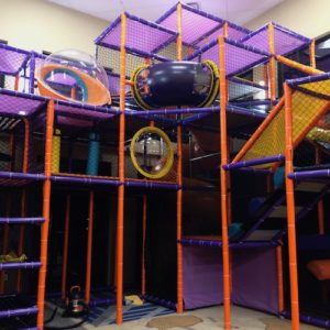 Go Play Systems Custom Design: Twenty foot tall indoor playground with crazy slide, vertical climbs and theming