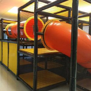 orange plastic enclosed slides and crawl tubes