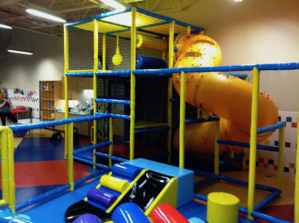 toddler area with small playground includes corkscrew slide and toddler slide components