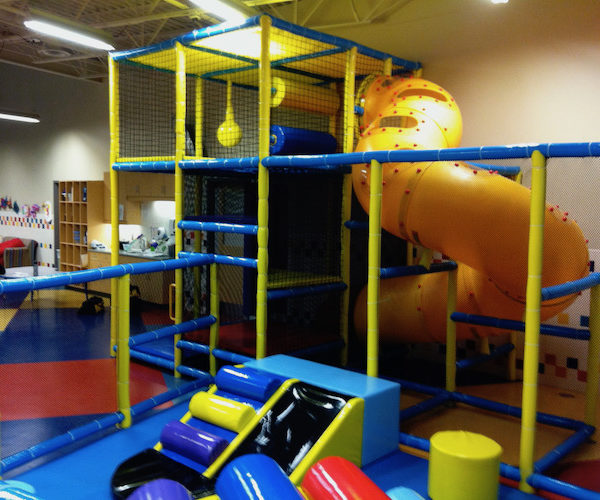 toddler area with small playground includes corkscrew slide and toddler slide
