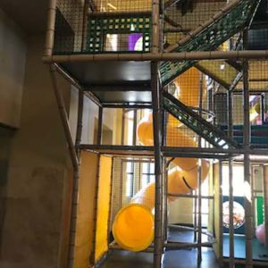 three story yellow spiral slide and climb inside youth ministry